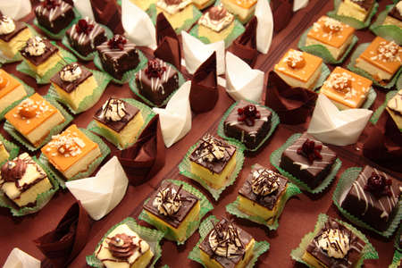 Varieties of cakes individual decorative desserts on the table at a luxury event, gourmet catering sweets Stock Photo - 21868907