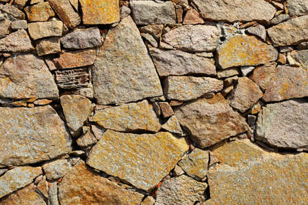 rock wall: Background of natural stone rock wall texture or cobblestone pavement detail