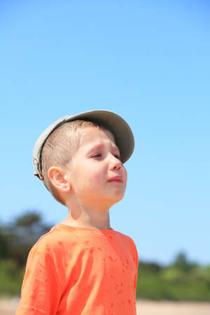 Portrait of crying unhappy little boy outdoor photo
