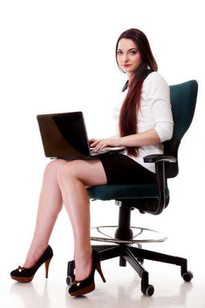 mmc: Young business woman working on laptop computer isolated on white background