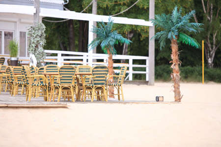 Outdoor beach restaurant open air cafe chairs with table photo