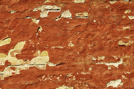 Old weathered painted red brown brick wall fragment grunge background photo