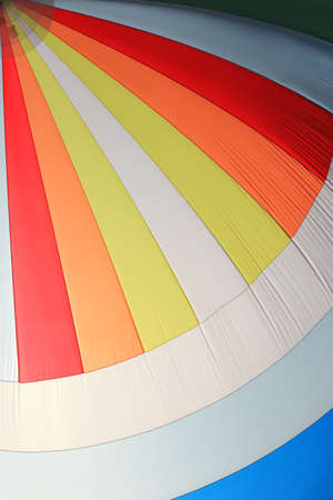 spinnaker: The wind has filled the spinnaker on sailing yacht. Detail of a colorful sail as background. Stock Photo