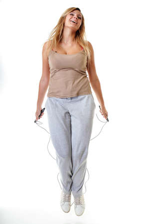 young sporty girl plus size doing exercise with jump rope - weight loss. Fitness woman isolated on white
