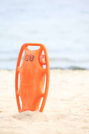 buoyancy: red plastic buoyancy aid in the sand Stock Photo