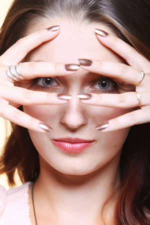 Autumn woman fashion female stylish creative make up false long brown eye lashes autumnal colour. Girl framing her face with hands photo