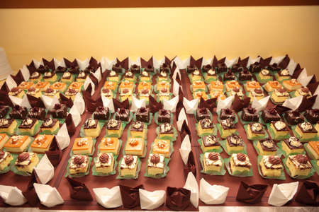 Varieties of cakes individual decorative desserts on the table at a luxury event, gourmet catering sweets Stock Photo - 22251138