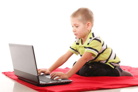 Computer addiction child boy with laptop notebook isolated on white background photo