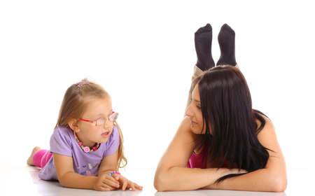 upbringing: Parenthood and children upbringing. Mother talking with daughter little girl isolated on white background
