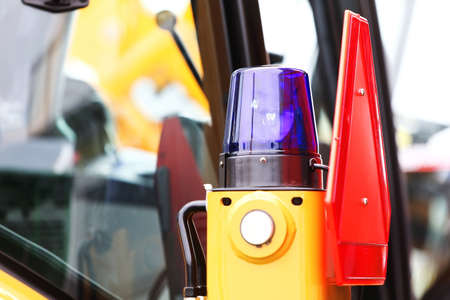 tractor warning: signal lamp for warning, flashing light on construction vehicle machine tractor, industry detail Stock Photo