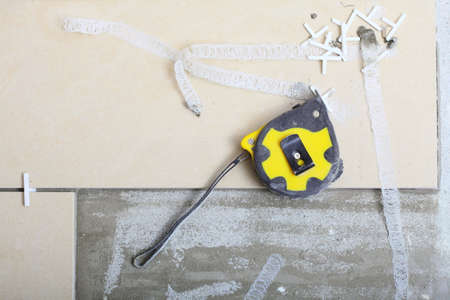 Improvement renovation at home, tape measure on concrete floor in construction site. Build concept. photo