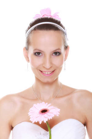 Wedding day. Young attractive romantic bride with pink flower gerbera daisy isolated on white background photo