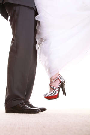 Wedding couple. Legs of the groom and the bride. Feet in footwear shoes indoor photo