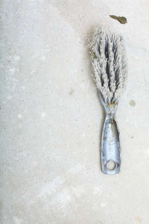 swept: Improvement renovation at home. Blank concrete house floor with broom, construction building site