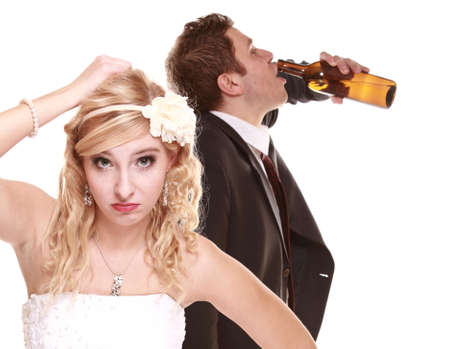 Wedding couple, unhappy bride with alcoholic drinking groom. Woman looking her future make a decision - violence alcoholism problems concept photo