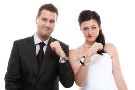 ex wife: Break up ending relationship between husband and wife. Couple in divorce crisis. Man woman unhappy holding hands in handcuffs. Isolated
