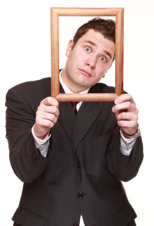imploring: Humorous business man getting his head out of empty frame desperate imploring facial expression, isolated on white  Stock Photo