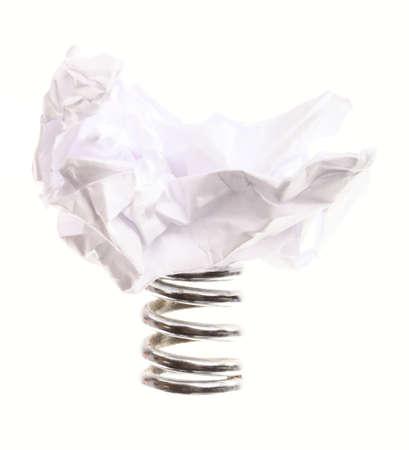 metal spring: Crumpled paper ball on metal spring