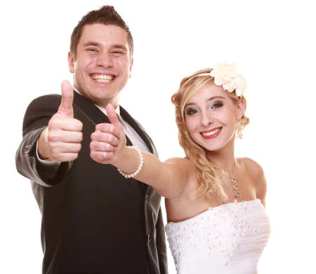 Wedding day. Portrait of happy bride and groom thumb up gesture  photo