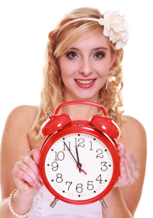 Wedding concept. Time to get married. Bride with wall clock. Beautiful blonde woman waiting for the groom isolated on white photo