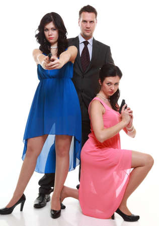 man detective secret agent criminal and two sexy spies women with gun.  photo