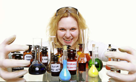 Crazy chemist woman or girl student or female laboratory assistant or scientific researcher with chemical glassware test flask.  photo