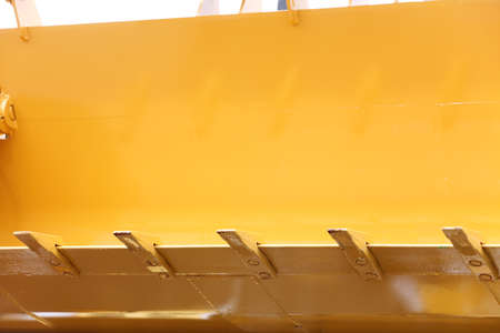 Close up digger excavator bucket bulldozer shovel yellow industrial background photo