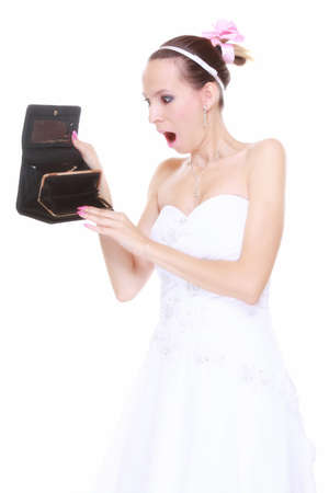 Marriage and money concept of high wedding cost. Bride with empty purse looking surprised isolated photo