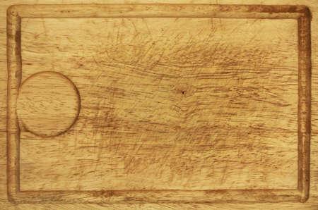 Old grunge wooden kitchen desk background texture. Full frame detail of a worn butcher block cutting board photo