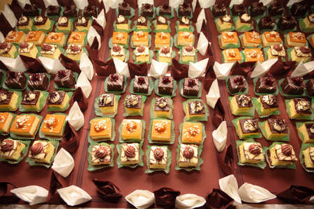 Varieties of cakes individual decorative desserts on the table at a luxury event, gourmet catering sweets photo