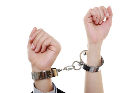Relationship between husband and wife.. Man woman hands in handcuffs. Isolated on white background photo