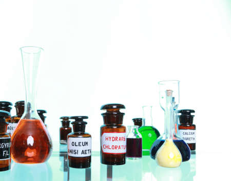 Various medicine glass bottles as pharmacy equipment, apothecary pots with ingredients for medicins isolated on white background photo