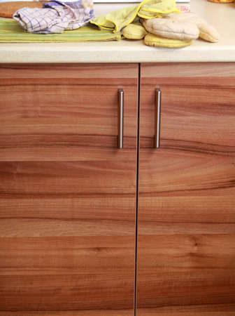 double oven: Close-up cupboard wood door cabinet in kitchen and top Stock Photo