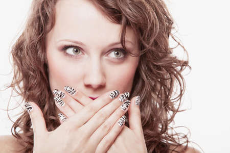 Speak no evil concept. Surprised woman face, girl covering her mouth with hands over white background photo