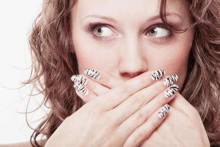 Speak no evil concept. Surprised woman face, girl covering her mouth with hands over white background