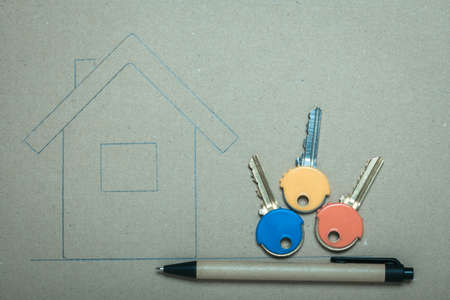 Hand drawn sketch house on recycled paper home symbol and colorful keys, real estate business & building concept. Stock Photo - 23451881