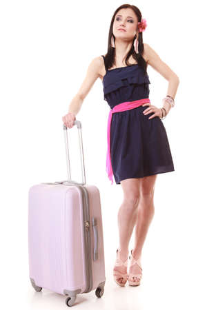 Full length of young summer fashion woman with pink suitcase luggage bag looking at wrist watch isolated on white . Travel vacation concept. photo