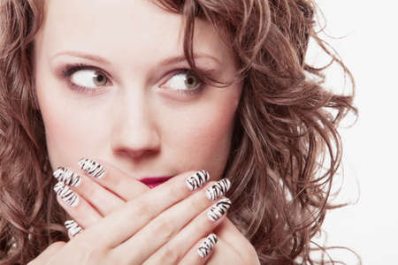 Woman covering her mouth with hands isolated over white  Stock Photo