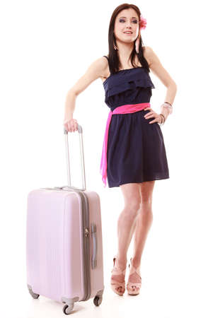 Full length of young summer fashion woman with luggage bag isolated on white. photo