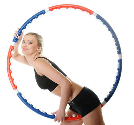 young sporty girl doing exercise with hula-hoop.  photo