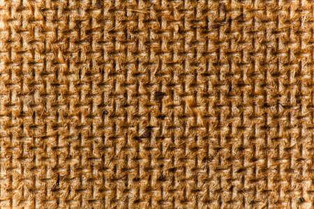 hardboard: Fiberboard texture pattern, brown abstract background. Rough side of a piece of hardboard light vignette