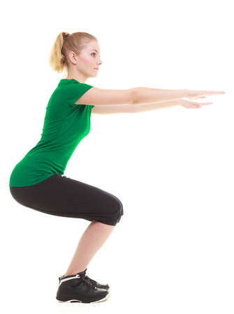 Full length young sporty woman fit fitness sport girl training doing stretching exercise isolated on white background. photo