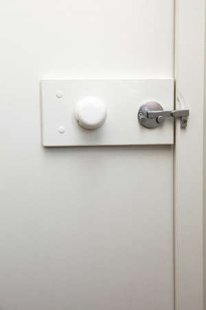 door bolt: lock latch on bathroom white door Stock Photo