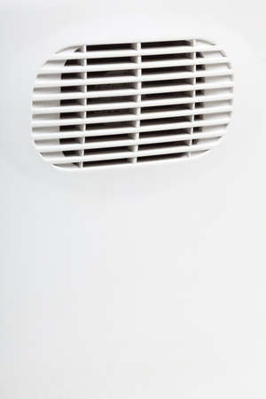plastic air vent in white wall ventilation grille photo