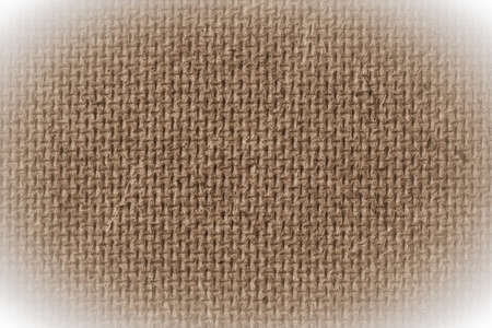 hardboard: Fiberboard texture pattern, brown abstract background. Rough side of a piece of hardboard with white vignette