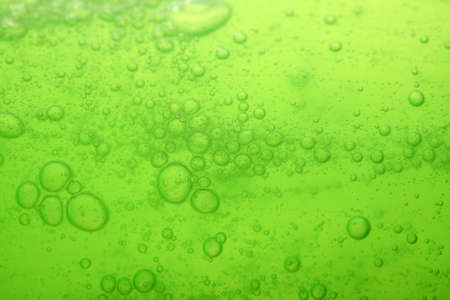 liquid soap: Green abstract blurred liquid background with soap bubbles