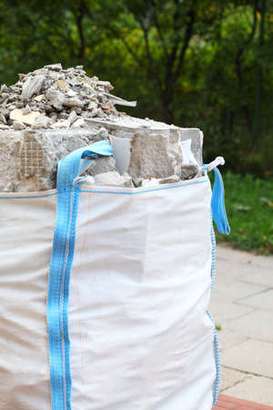 demolished house: Full construction waste debris bags, garbage bricks, pile of rubble and material from demolished house