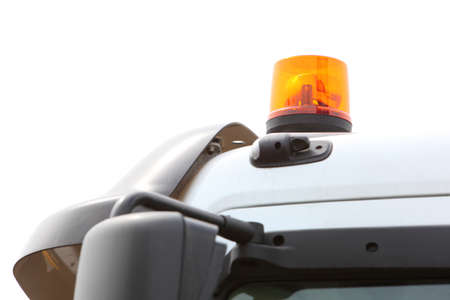 Orange siren signal lamp for warning, flashing light on vehicle, industry detail Stock Photo