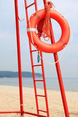 buoyancy: Beach life-saving. Lifeguard rescue equipment orange lifebuoy buoyancy aid