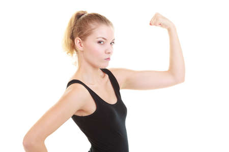 sportwear: Fitness woman showing fresh energy flexing biceps muscles isolated on white background. Funny girl in sportwear energetic and fun.